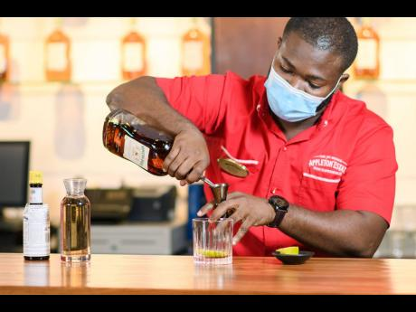 Randeen Thomas, bartender/mixologist at Appleton Estate, works his magic during the 'Make Your Mix' session at the Joy Spence Appleton Estate Rum Experience.