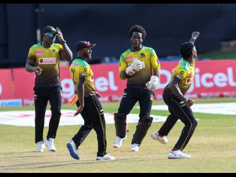 Photo by Randy Brooks – CPL T20/CPL T20 via Getty Images Fidel Edwards (right), Rovman Powell (left), Jermaine Blackwood (second left) and Chadwick Walton of Jamaica Tallawahs celebrate the dismissal of Chris Lynn of St Kitts & Nevis Patriots during the