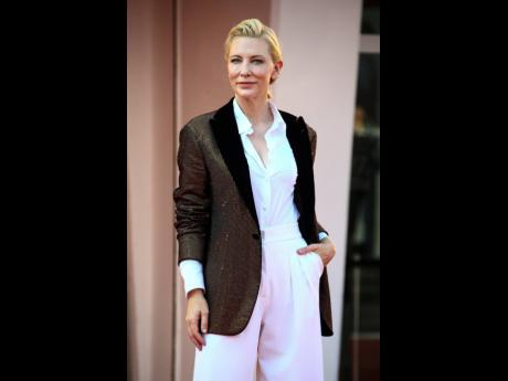 Jury president Cate Blanchett poses for photographers upon arrival at the premiere of the film 'Khorshiad (Sun Children)'.