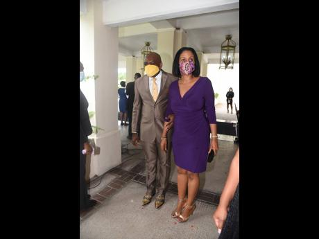 Floyd Morrison and his stunning wife, Shelley-Ann, make quite an entrance at Andrew Holness' swearing-in on Monday. Morrison attended the function on the behalf of presumptive Opposition leader, Dr Peter Phillips.