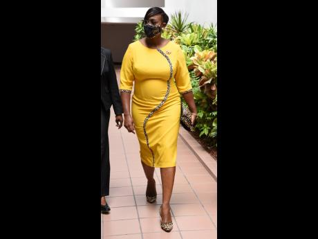 Newly-appointed Deputy Speaker of the House of Representatives, Juliet Holness, makes her entrance at the Jamaica Conference Centre in a yellow three-quarter sleeve dress accented down to the custom mask with leopard print.