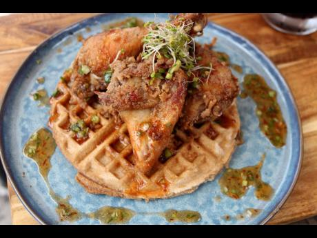 Chef Noel's famous coconut marinated jerk fried chicken and waffles.