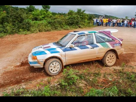 The McDowell brothers in their classic Mazda 323 GTX rally car at a previous Rally Jamaica event.
