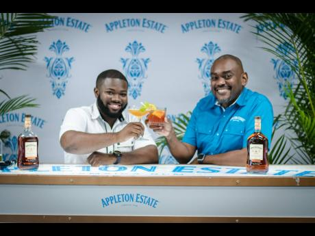 Senior Blender at Appleton Estate, David Morrison, and Mixologist, Randeen Thomas toast to excellence at the 'Home is Where the Rum is' mixology session.