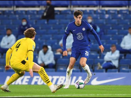Barnsley's Callum Styles (left) tries to stop Chelsea's Kai Havertz, during the English League Cup third round match between Chelsea and Barnsley at Stamford Bridge in London, yesterday.