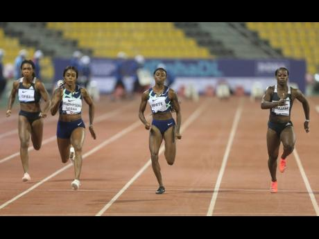 Jamaica's Elaine Thompson Herah (second left) comes through to win the women's 100m at the Wanda Diamond League in Doha, Qatar, yesterday.