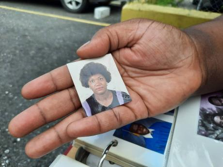 Kara Edwards holds a photo of her late mother, Juliet Wilson.