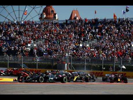 Mercedes driver Valtteri Bottas of Finland (left) leads the field during the Russian Formula One Grand Prix, at the Sochi Autodrom circuit, in Sochi, Russia, yesterday.