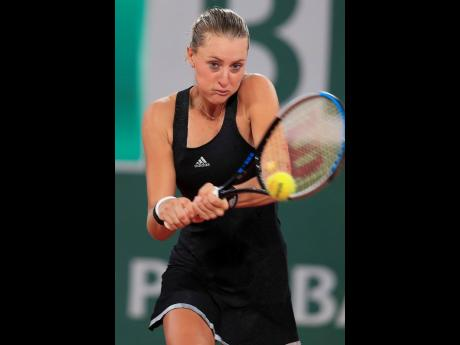 Kristina Mladenovic plays a shot against Laura Siegemund in the first round match of the French Open tournament at the Roland Garros stadium in Paris, France, yesterday.
