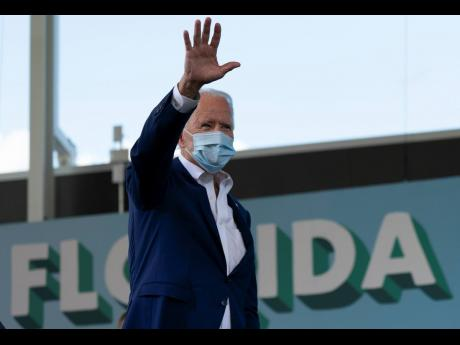 Democratic presidential candidate former Vice-President Joe Biden waves to the crowd at Miramar Regional Park in Miramar, Florida, on Tuesday. AP