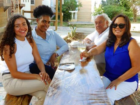 Frank Rance (3rd left) with, from left, daughter Victoria,  manager of L'Escargot restaurant, Trishawana Davidson, executive assistant manager at FDR, and his wife Angella.