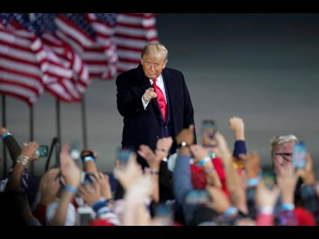 President Donald Trump arrives at a campaign rally at Des Moines International Airport, Wednesday, October 14, 2020, in Des Moines, Iowa.