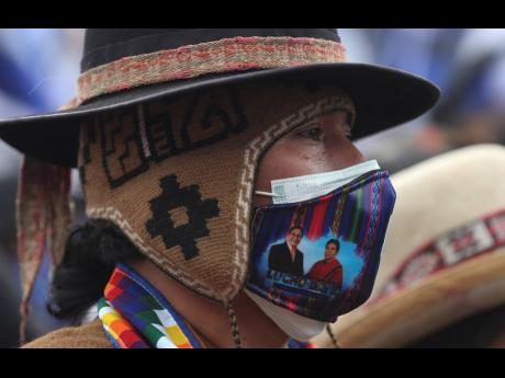 A supporter of Luis Arce, who is running for president for the Movement Towards Socialism Party, attends Arce's closing campaign rally in El Alto, Bolivia on Wednesday.
