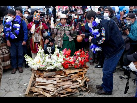 Presidential candidate Luis Arce, from the Movement Towards Socialism Party, prepares an offering to the 'Pachamama', or Mother Earth, during his closing campaign rally in El Alto, Bolivia, on Wednesday. Elections will be held October 18.