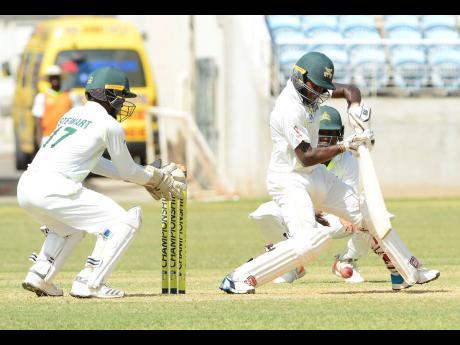 Jamaica Scorpions batsman Jermaine Blackwood (right) plays a shot during the Scorpions' second innings of the Cricket West Indies Professional Cricket League  Regional Four-Day cricket  match against the Windward  Islands Volcanoes  at Sabina Park on  Sa