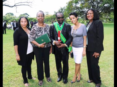Frederick 'Toots' Hibbert (centre) received the Order of Jamaica in 2012. Here he shares the moment with members of his inner circle (from left) public relations agent Andrea Davis; his wife Doreen Hibbert; granddaughter Cressida Rattigan; and family f