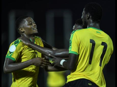 Reggae Boyz striker Leon Bailey (left) celebrates with  Devon Williams (partially hidden) and Shamar Nicholson during Jamaica's Concacaf Nations League match against Antigua and Barbuda at the Montego Bay Sports Complex on Friday, September 6, 2019. Jama