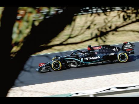 Mercedes driver Lewis Hamilton steers his car during qualification for the Formula One Portuguese Grand Prix at the Algarve International Circuit in Portimao, Portugal, yesterday. The Formula One Portuguese Grand Prix will take place today.