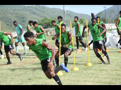 Members of Jamaica's national senior men's football team go through an exercise during a training session at the University of West Indies/Jamaica Football Federation/Captain Horace Burrell Centre of Excellence on August 27, 2019.