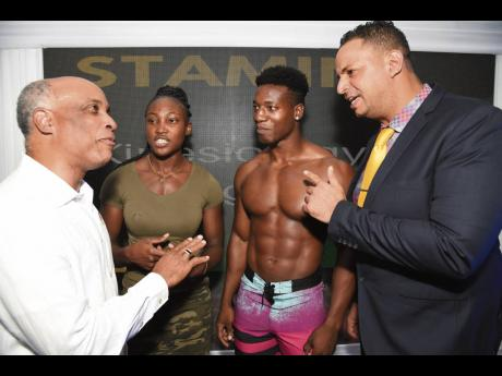 FILE Christopher Samuda (left), president of the Jamaica Olympic Association (JOA), talks with Kirsten McGregor (second left), Adam Senior (second right) and Kirk Frankson (right), JABBFA secretary general, during a press conference by the IFBB-JOA-JABBFA