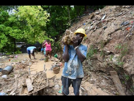 Yesterday, residents of Shooters Hill in East Rural St Andrew desperately searched for the body of 15-year-old Saneeka Leechman, who was buried under the rubble after her board house collapsed on Friday following heavy rainfall that caused a landslide. Her
