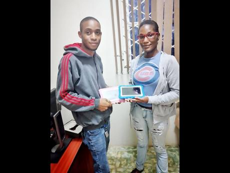 Businessman Donrol Whyte donates two tablets to Acia Wills to assist with her three children accessing online classes. In a story published on Friday, October 23, Wills, who lives in Porus, Manchester, described how she juggled a single device among her ch