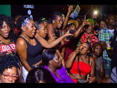 Section of a crowd at a dancehall event.