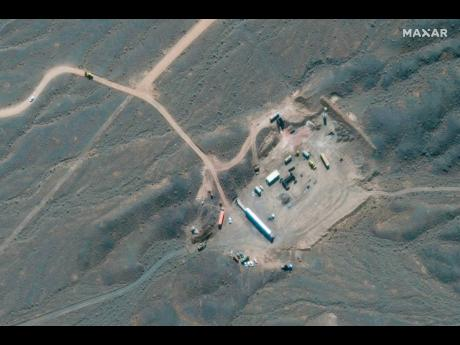 In this Wednesday, Oct. 21, 2020, satellite photo provided by Maxar Technologies, shows construction at Iran's Natanz uranium-enrichment facility that experts believe may be a new, underground centrifuge assembly plant. Satellite photos show Iran has begun