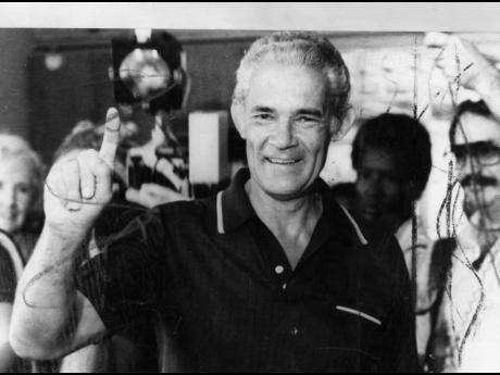 Prime Minister Michael Manley in the process of casting his vote at Annette Crescent in St Andrew North Central on October 30, 1980.