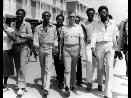 JLP Leader Edward Seaga (third right), accompanied by councillors and party supporters, walks towards the Western returning office at the Denham Town Secondary School, where he was nominated for the October 1980 election.
