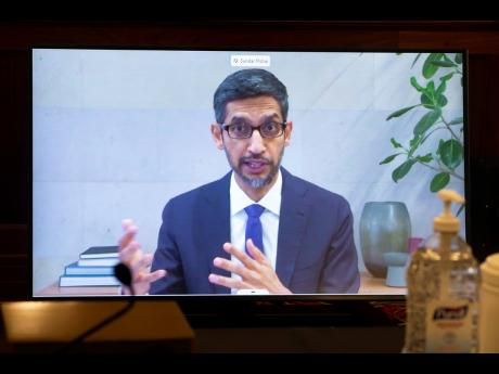 Google CEO Sundar Pichai appears on a screen as he speaks remotely during a hearing before the Senate Commerce Committee on Capitol Hill, Washington, on Wednesday, October 28.