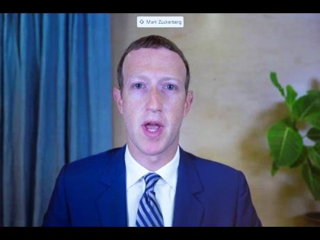 Facebook CEO Mark Zuckerberg appears on a screen as he speaks remotely during a hearing before the Senate Commerce Committee on Capitol Hill, Washington, on Wednesday, October 28.