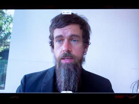 Twitter CEO Jack Dorsey appears on a screen as he speaks remotely during a hearing before the Senate Commerce Committee on Capitol Hill in Washington on  Wednesday, October 28.
