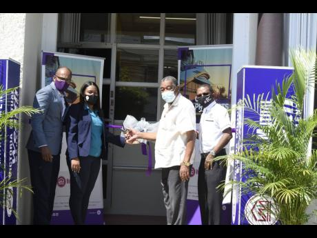 From left: Rezworth Burchenson, chief executive officer, Victoria Mutual Wealth Management; Allison Shields, VMBS Savanna-la-Mar branch manager; Councillor Bertel Moore, Savanna-la Mar mayor; and Courtney Campbell, president and CEO, Victoria Mutual ??  at