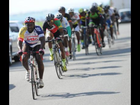 Local riders engage in a Jamaica Cycling Federation road race staged at the Kingston waterfront on Sunday, December 3, 2017.