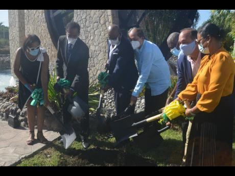 Tourism Minister Edmund Bartlett (third left) participates in a groundbreaking exercise for the creation of the new Linkages Centre of Excellence at The Shoppes in Rose Hall, St James. Also pictured are (from left) Joy Roberts, executive director of Jamaic