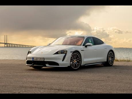 This undated photo provided by Porsche shows the 2020 Porsche Taycan, Porsche's first all-electric car.