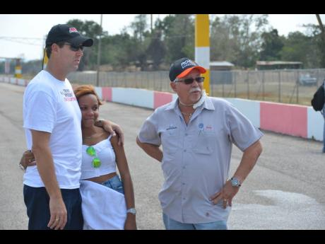 Racer Doug Gore and wife Shanice stand with crew chief,  David 'DBELL' Bell (right), who passed away earlier this year.