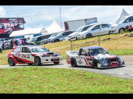 Sara Misir and her Pro Truck leads Vivian Mitchell in his Civic through the chicane.