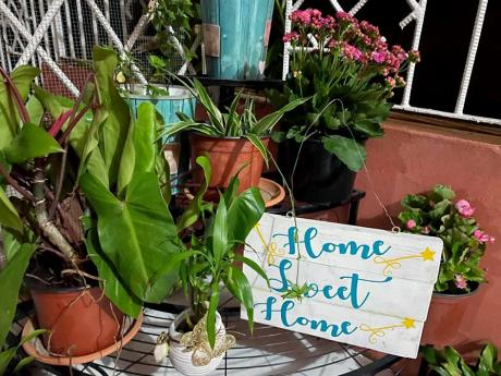 The famed home sweet home sign welcomes visitors to Cowans' garden.