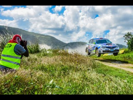 The late Mikey Spice in action capturing Lee Vaz airborne at Rally Jamaica 2019.