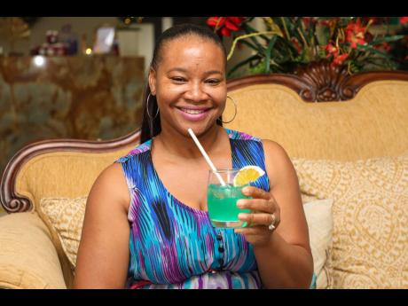 Denise James enjoys a specially blended cocktail just before her spa treatment.