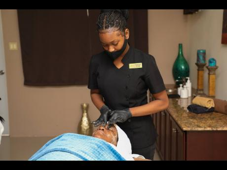 Ruthlyn Williams receives a facial treatment from spa therapist Samantha Kelly.