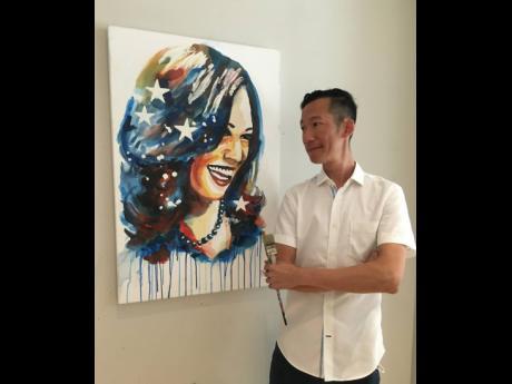 Phillip Fung smiles at his 'Kamala' portrait of United States Vice-President-elect Kamala Harris.