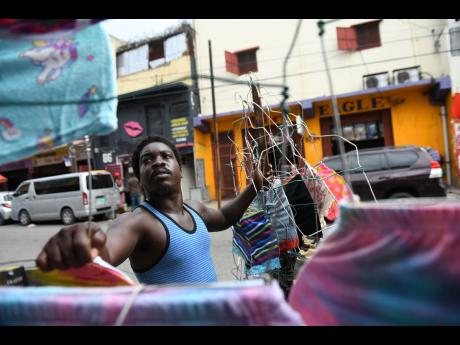 Clothes vendor Jeremiah Bryan, who operates on Orange Street in downtown Kingston, says that relaxing the COVID-19 curfew for the Christmas season is not worth the risk.