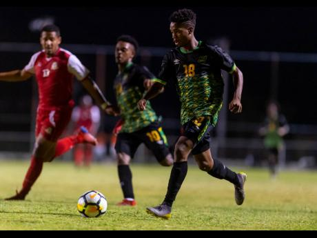 Jamaica's Lamar Walker (right) in action ahead of teammate and team captain Alex Marshall (centre) and opponent Ezrick Nicholls of St Kitts and Nevis in an Olympic Games qualifying match at the Anthony Spaulding Sports Complex on Sunday, July 21, 2019.