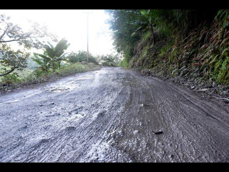 The road through Silver Gap, Content, and Guava Ridge, the proposed route to the now-closed Gordon Town main road, is littered with potholes and is unpaved in many areas.