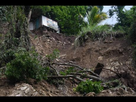 Peter Clarke's house on the edge. The foundation was severely damage by a massive landslide during Heavy rains from Tropical Storm Eta