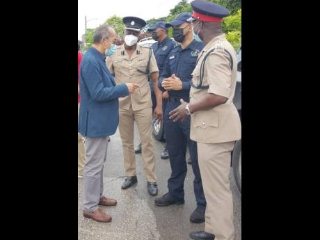 From left: National Security Minister Dr Horace Chang discusses plans for the construction of a new police station in Mount Salem with Superintendent Vernon Ellis, head of the St James Police Division; Police Commissioner Major General Antony Anderson; and