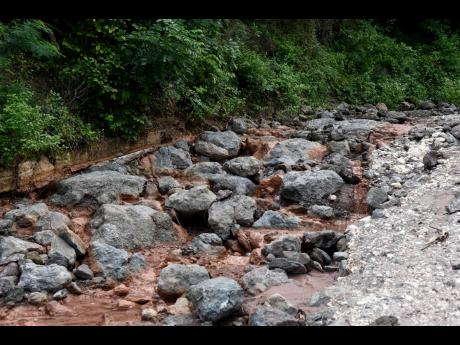 The main road to Bito and Bloxburgh in St Andrew East Rural has been destroyed. Both communities, which are home to a handful of residents, are now marooned. Residents have resorted to walking an estimated 2.5 miles to Cane River to get a taxi to get to Bu